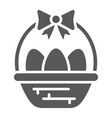 easter eggs in basket glyph icon decoration and vector image vector image