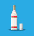 bottle of vodka with shot glass vector image vector image