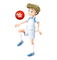 A boy using the ball with the flag of Hongkong vector image vector image