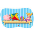 piggybank and other toys on wooden shelf vector image vector image