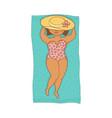Plump woman in swimsuit lying on beach mat