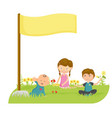happy kids playing in grass with a banner vector image vector image