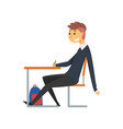 male student sitting and writing at desk in vector image vector image