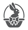 easter bunny in basket glyph icon easter and vector image vector image