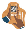 hand holding smartphone with qr payment screen vector image