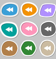 rewind icon symbols Multicolored paper stickers vector image vector image