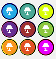Table lamp Icon sign Nine multi colored round vector image