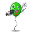 singing green ballon with cartoon ribbons