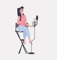 woman blogger recording music video blog in studio