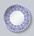 plate decorated with blue floral patterns in the vector image vector image