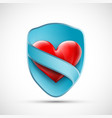 red heart on shield with blue ribbon vector image