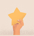 raised up arm holding star costumer feedback or vector image