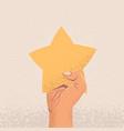raised up arm holding star costumer feedback vector image