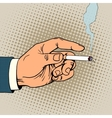 Hand with a smoking cigarette vector image