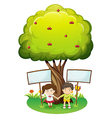 Kids under the tree with empty signboards vector image vector image