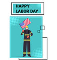 firefighter in uniform holding usa flag labor day vector image vector image