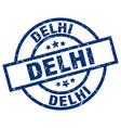 delhi blue round grunge stamp vector image vector image