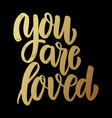 you are loved lettering phrase on dark background vector image vector image