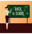 back to school female teacher in a classroom vector image