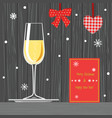 glass of champagne on tray and christmas card vector image vector image