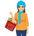 smile woman holding a shopping basket full of food vector image vector image