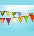 Vintage colorful bunting over sky background vector image