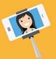 young girl making a photo with stick selfie vector image