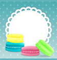 colorful macaroons on a light blue background vector image