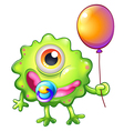 A green monster baby with a balloon