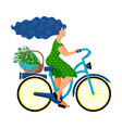 a young woman in a green dress rides a bicycle vector image vector image