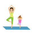 mom and daughter doing yoga vector image