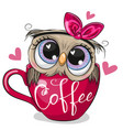 owl with a bow is sitting in a cup coffee vector image vector image