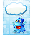 A happy blue monster with an empty cloud callout vector image vector image