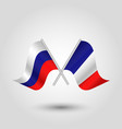 two crossed russian and french flags vector image vector image