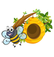 A smiling bee near the big beehive vector image vector image