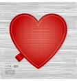 Valentines kniited heart on a wood background vector image