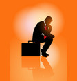 pensive businessman sitting on his briefcase vector image vector image