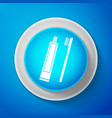 white tube of toothpaste and toothbrush icon vector image