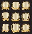 golden shields laurel wreath with golden ribbon vector image vector image