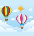 two balloons flying in blue sky vector image