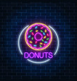 neon glowing sign of donuts in circle frame on a vector image