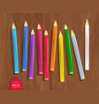 color pencils on wooden desk background vector image vector image