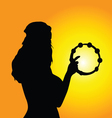 girl tambourine silhouette vector image vector image