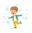cute happy little boy playing bubbles vector image vector image