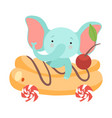 cute little elephant riding toy car made eclair vector image vector image