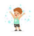 happy redhead boy playing bubbles vector image vector image