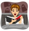 Afraid little boy reading horror book indoors vector image vector image