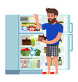 man stands fridge chooses food modern flat vector image vector image