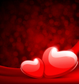 two red shiny hearts on silk with light vector image vector image