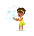 cute smiling little girl playing bubbles vector image vector image